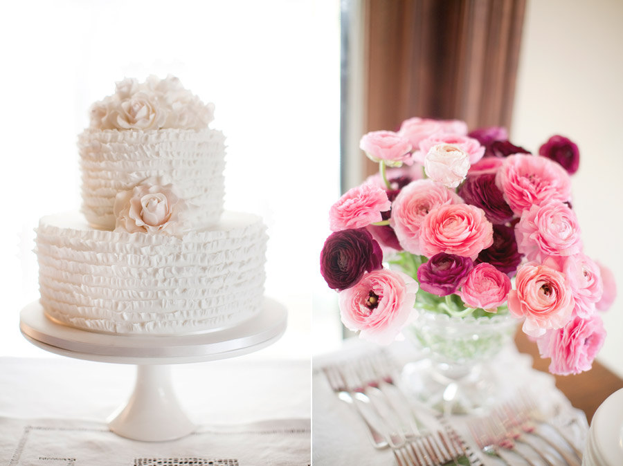 White wedding cake perth next to a bouquet of roses